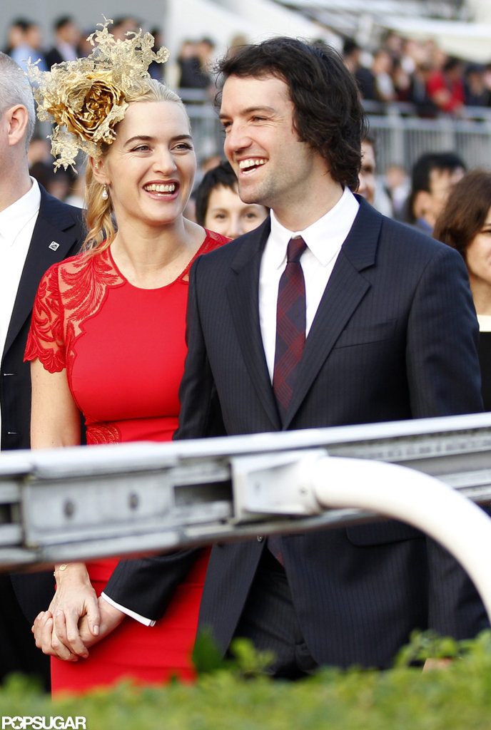 Kate Winslet and Ned Rocknroll held hands at a horse race.