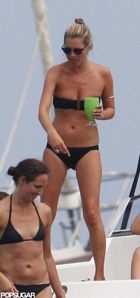Kate Moss partied with family and friends on a yacht in Saint-Tropez back in August and showed off her model physique in a strapless black bikini.