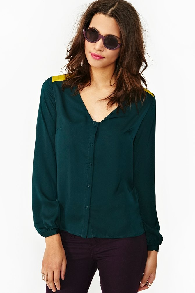 Keep it interesting with this Nasty Gal two-tone drape blouse ($58). Sure, it's emerald-colored and buttoned-down from the front, but from the back? It also has a sexy cutout and yellow colorblocked detail.