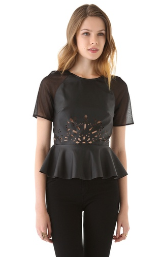This Three Floor faux leather peplum top ($165) has too many cute details: peplum, sheer sleeves, and laser cuts.