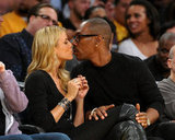 Eddie Murphy shared a kiss with Paige Butcher in their courtside seats at a November Lakers game.