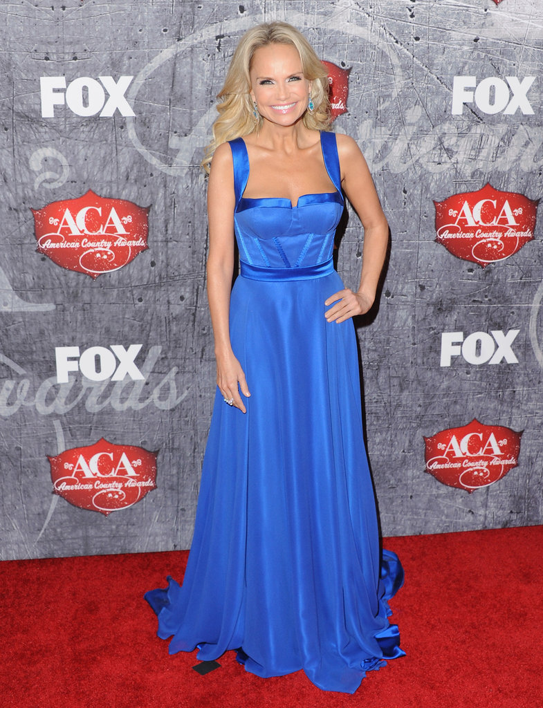 Kristin Chenoweth worked the red carpet in multiple dresses, including this bright blue frock.
