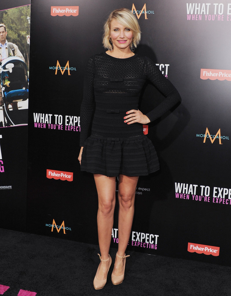 Cameron Diaz gave a glimpse of her famous gams in a black fit-and-flare Valentino mini in May.