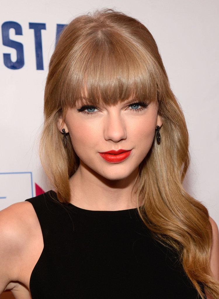 Taylor celebrated Z100's Jingle Ball in New York City last year. She wore a classic LBD and stuck with her tried-and-true makeup look: winged black liner with red lips. When it's not broken, why fix it?