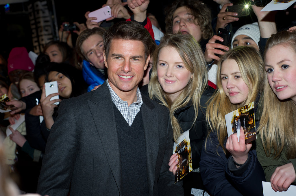 Tom Cruise posed for photos with fans.
