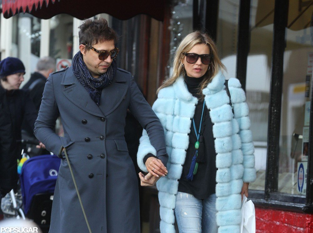 Kate Moss wore a blue fur coat to take her dog for a walk with Jamie Hince.
