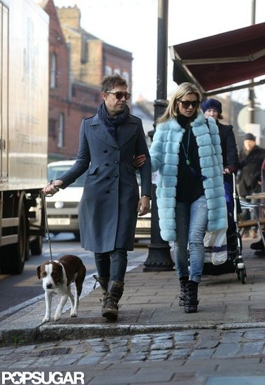 Kate Moss held onto Jamie Hince as they walked their dog together in London.