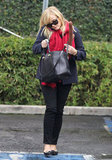 Reese Witherspoon carried oversize reindeer antlers in her bag.