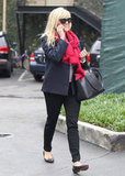 Reese Witherspoon chatted on her cell phone while walking back to her car.