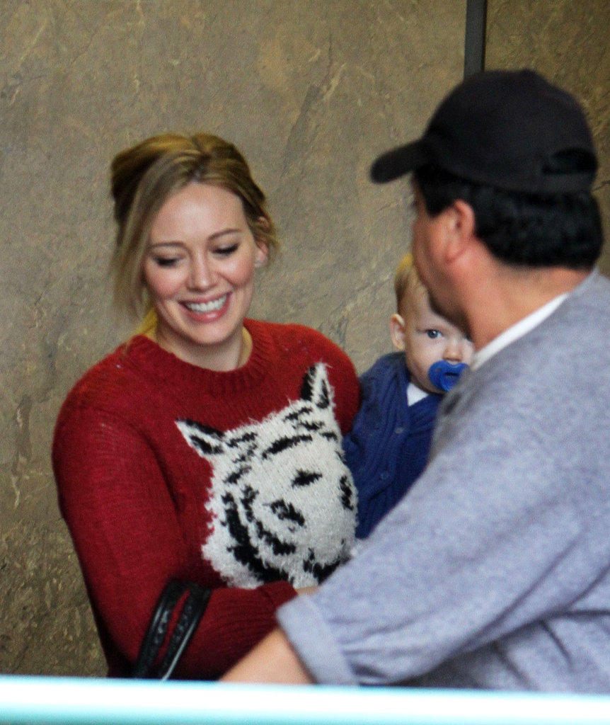 Hilary Duff sported a red sweater.