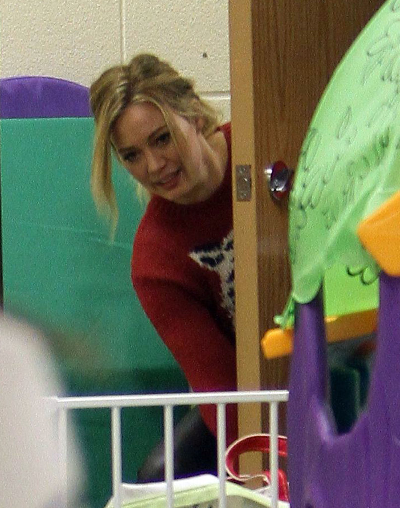 Hilary Duff leaned behind a door to check on Luca Comrie.