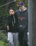 Ashton Kutcher had his arm around Mila Kunis.