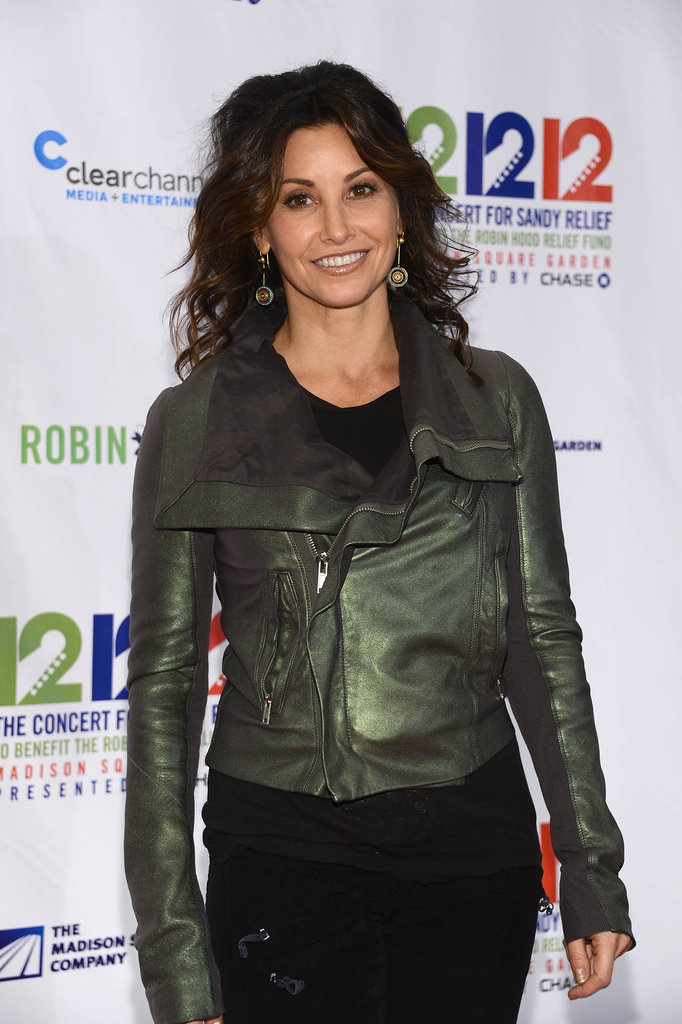 Gina Gershon was on the red carpet at the 12-12-12 Robin Hood Relief Fund concert in NYC.