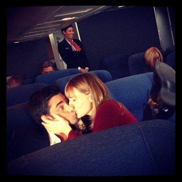Some lucky girl stole a smooch from John Stamos while shooting a commercial. Source: Instagram user johnstamos
