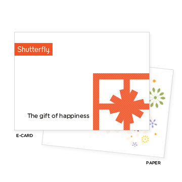 Give her a Shutterfly gift card ($10-$100), then help her create a personalized photo book using all your holiday photos.
