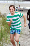 Ed Westwick make a quick dash away from the beach during a June 2008 trip to NYC's Rockaway Beach.