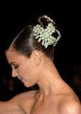 For her 2007 appearance at the Vanity Fair Oscar party, Katie wore jewels in her hair. The mint hairpiece fit around her sleek bun, and her makeup was full of flushed rose hues to complement the stunning accessory.