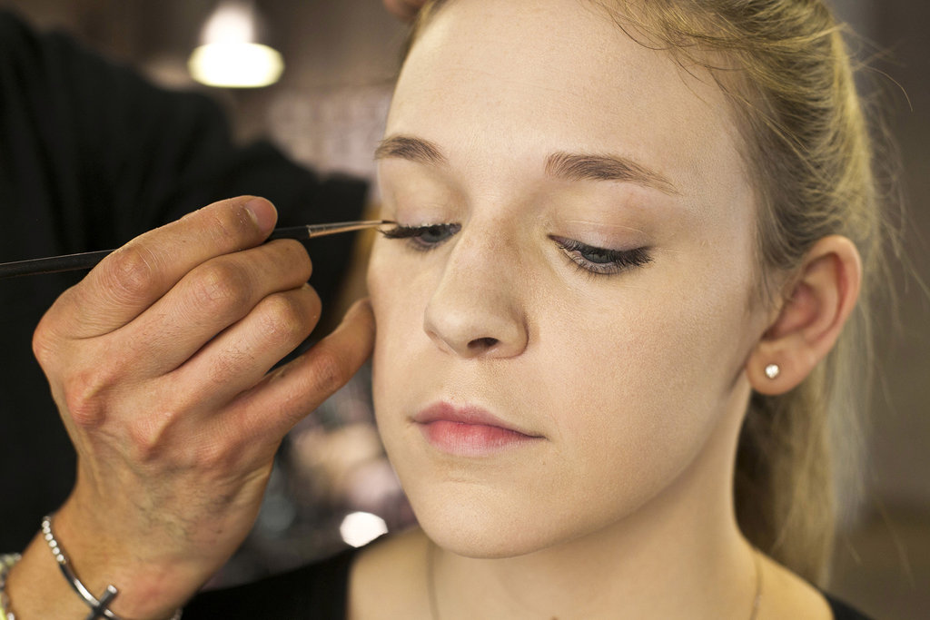 """For piece of mind, you can go back with an eyeliner brush if you feel that you've missed some spots,"" Jennings says. ""You can just dot a few pieces of glue just for reinforcement. So if you see any gaps, you can absolutely fill and adhere the lash."" In case you're worried about stiffening your brush, just wipe off the excess glue and the rest will come off with soap and warm water. Source: Caroline Voagen Nelson"