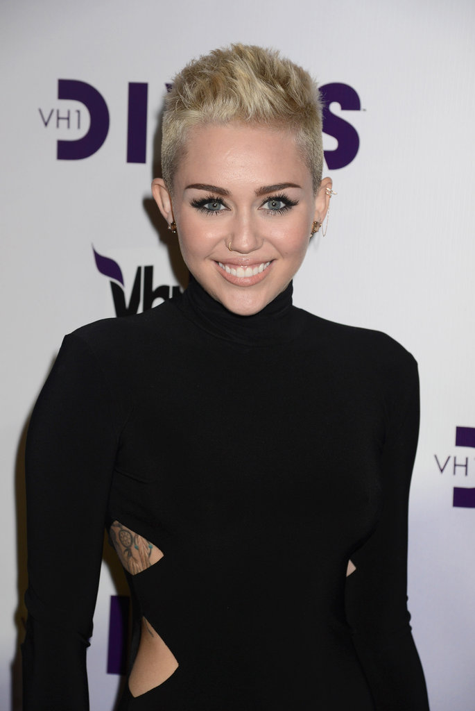 Miley Cyrus smiled for the cameras.