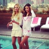 Miranda Kerr and Candice Swanepoel struck a pose by the pool in LA, despite the chilly weather, as they promoted the new Victoria's Secret collection.