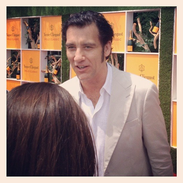 Clive Owen flashed his sexy smile in our direction at this year's annual Veuve Clicquot Polo Classic in NYC.