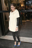 Olivia Palermo added chicness to her leather bottoms with a short-sleeved white cocoon coat.
