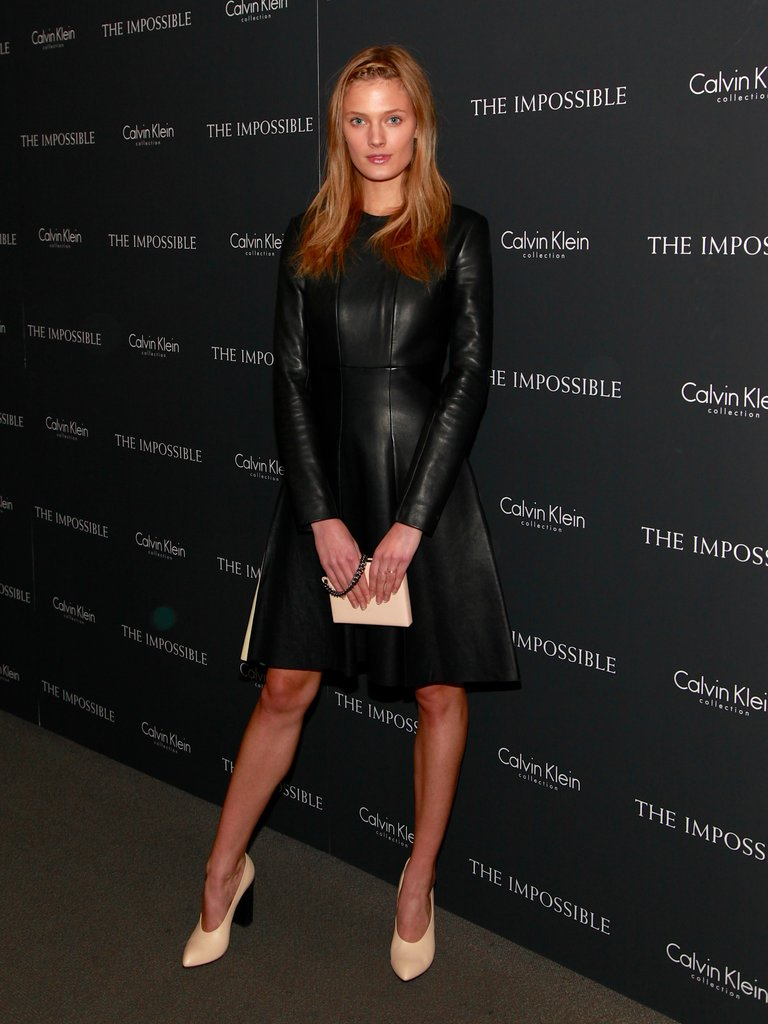 Constance Jablonski wore a long-sleeved leather Calvin Klein dress with ladylike nude heels.