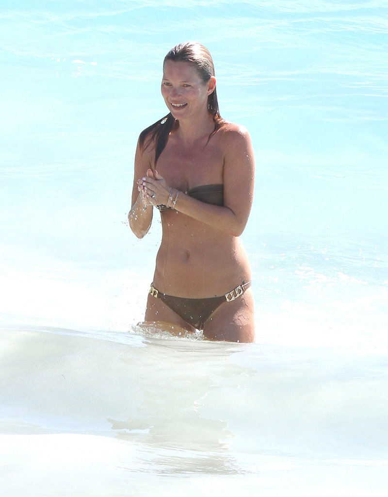 Kate Moss laughed in the waves.
