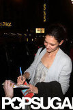 Katie Holmes signed autographs on her birthday.