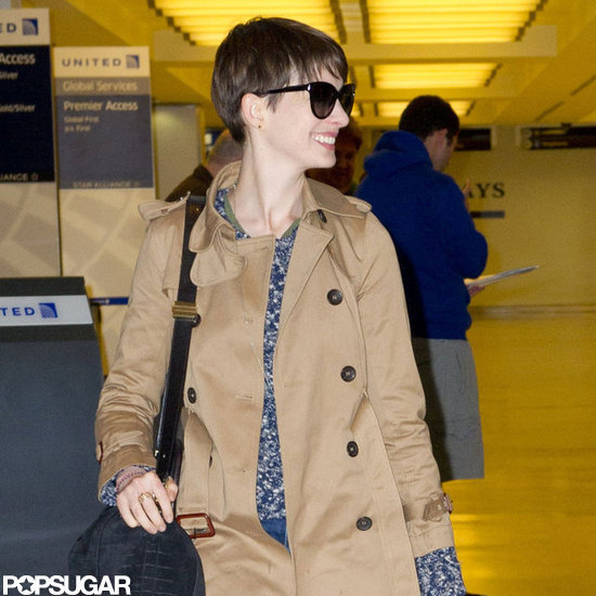 Anne Hathaway was all smiles at the airport.