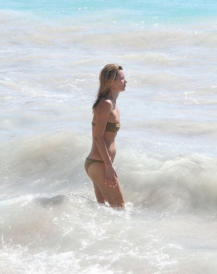 Kate Moss played around in the surf.