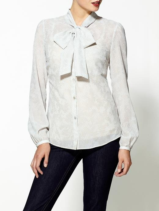 This Ark & Co. tie-neck blouse ($45, originally $59) would be a great foundation to building any girlie look. You can wear it with wide-leg denim on the weekend and trousers for the office. Throw on a vest for added interest.