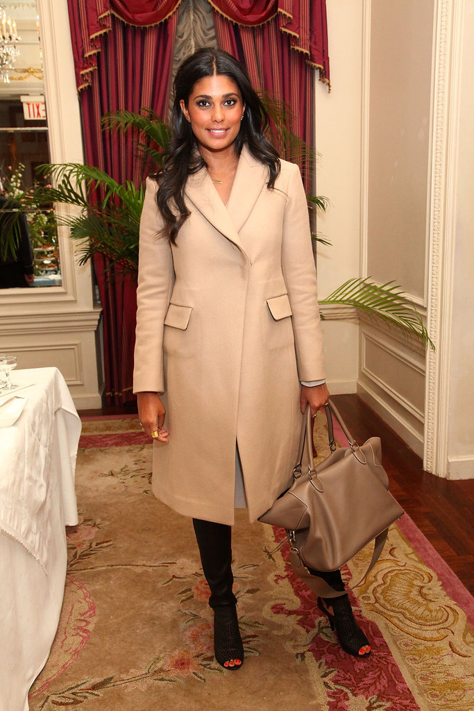 Rachel Roy made an elegant arrival in a creamy overcoat and open-toe booties.