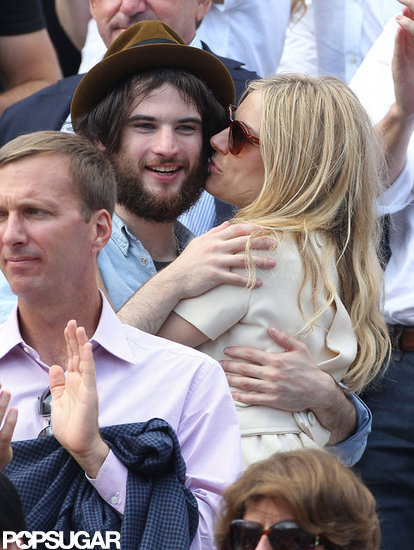 Tom Sturridge and Sienna Miller cuddled during the French Open in Paris in June 2011.