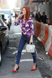 Taylor Tomasi Hill carried the mini white Céline Luggage Tote with a floral blouse and two-toned pumps in NYC.
