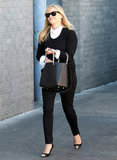 Reese Witherspoon paired her metallic-toed pumps with a black and white ensemble.