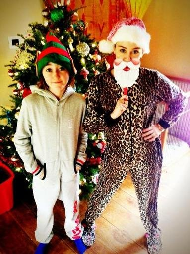 Miley Cyrus wore a Santa mask while dressing up in her Christmas pajamas.  Source: Twitter user MileyCyrus