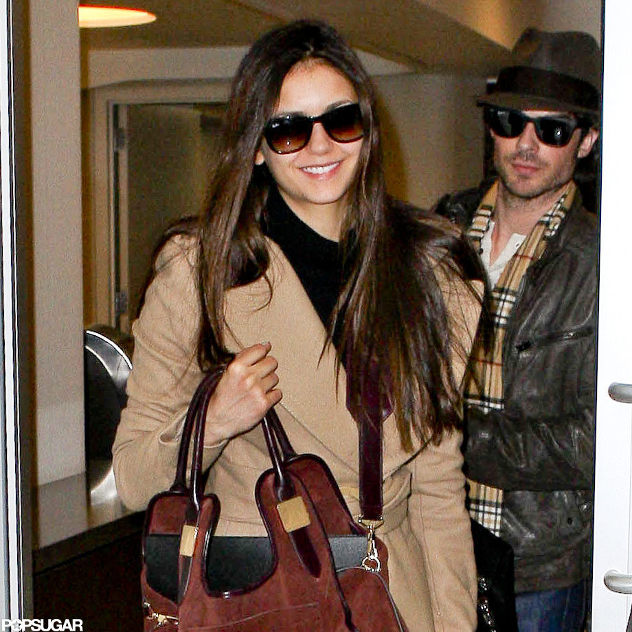 Nina Dobrev flashed a smile at fans.