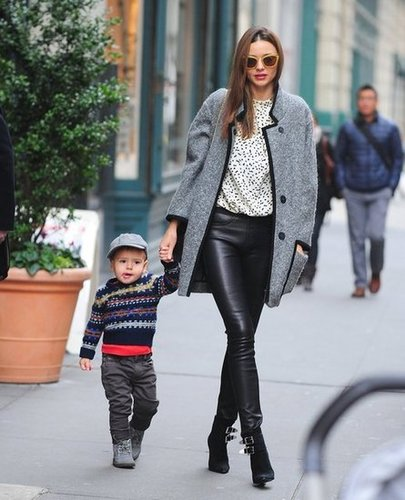Miranda really loves her tweed Isabel Marant coat — and we can see why! She styled it up again on a walk with son Flynn with a pair of Helmut Lang leather leggings, Tabitha Simmons boots, and a printed cream top, finished off with a pair of yellow sunglasses.