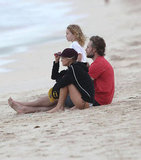 Eric Johnson sat on the beach with Ashlee Simpson and Bronx Wentz.