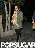 Katy Perry paired a scarf with an olive coat.