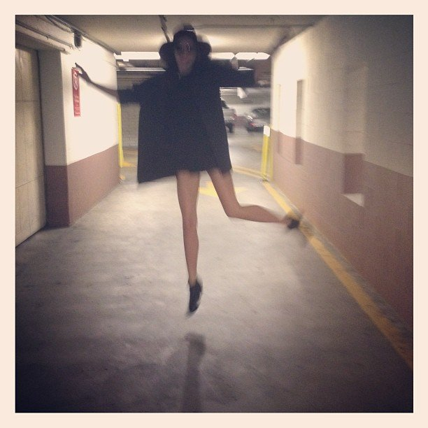Miranda Kerr did a jump for joy inside a car park. Source: Instagram user mirandakerrverified