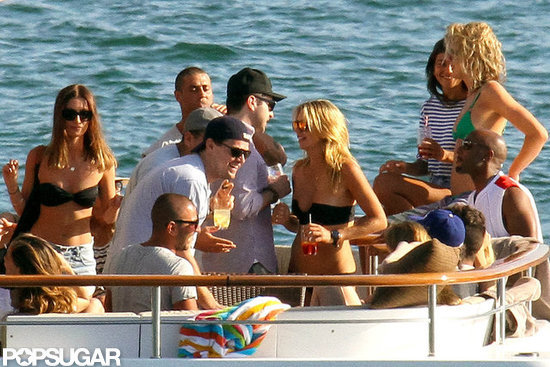 Leonardo DiCaprio joked around with a bikini-clad female.