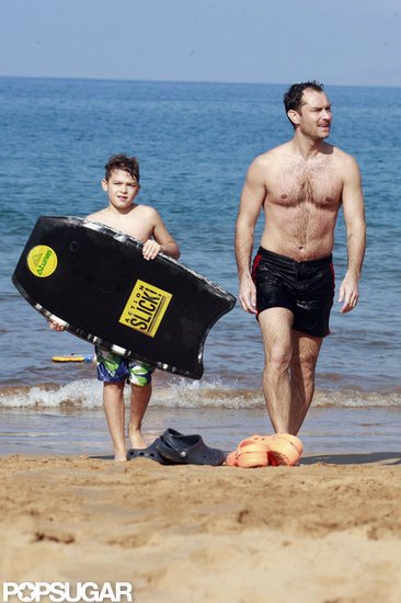 Shirtless Jude Law Catches a Wave and Bodysurfs With His Son