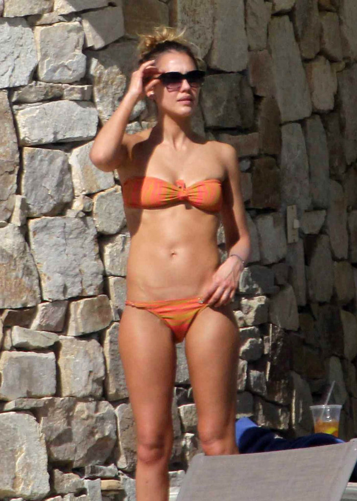Jessica Alba sported a skimpy orange bikini while in Mexico with her family in January 2013.