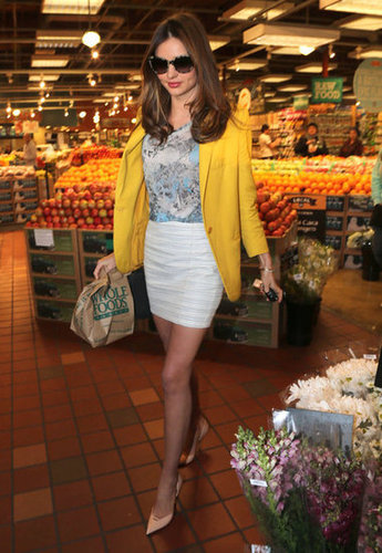 Miranda Kerr made a recent trip to Whole Foods look downright glamorous — she added a vibrant yellow Stella McCartney blazer to her white miniskirt and printed blouse, then added a pair of pointy-toe pumps for a pitch-perfect business-casual look.