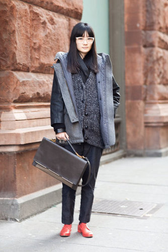 This styler transforms black and gray everyday wear with a sleek bag and fiery footwear. Source: Adam Katz Sinding