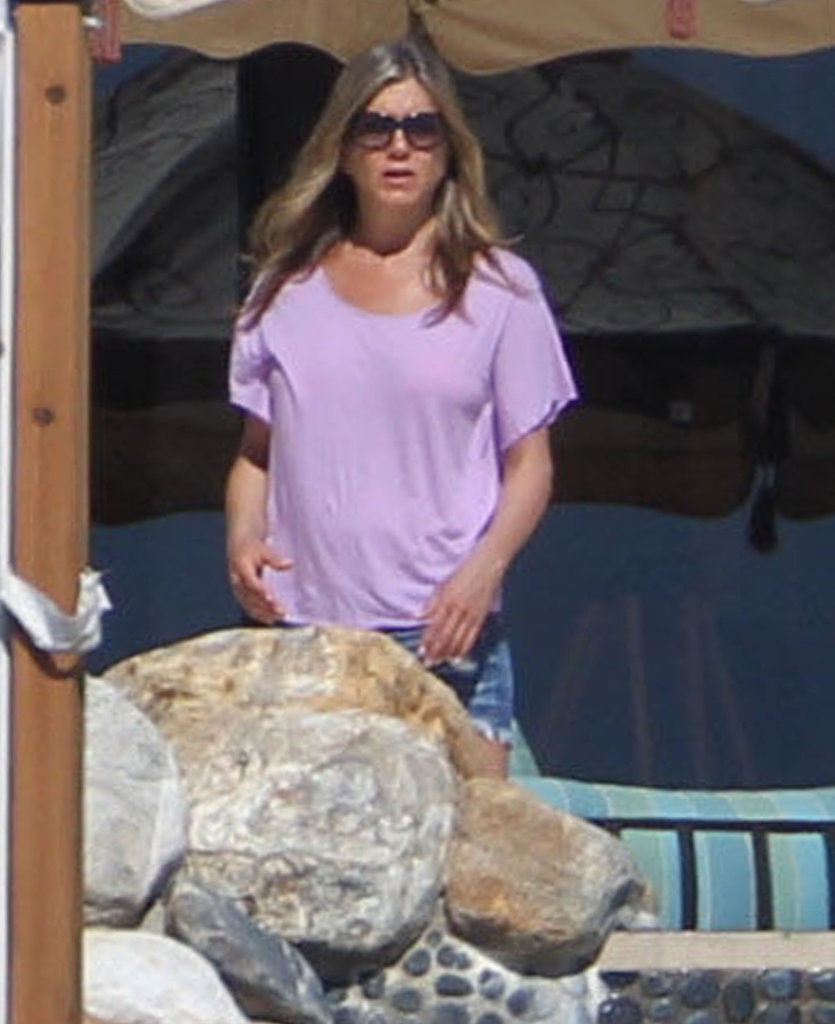 Jennifer Aniston covered up in a purple t-shirt.