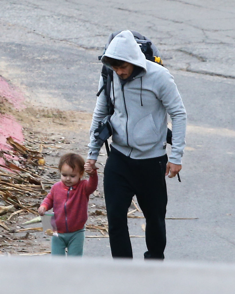 Flynn Bloom held onto dad Orlando Bloom's hand.