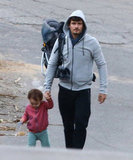 Orlando Bloom walked with baby Flynn in LA.
